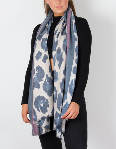 an image showing a cashmere mix animal print scarf in navy