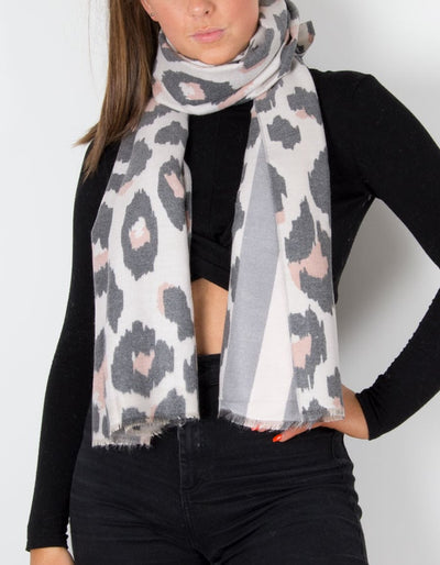 an image showing a cashmere mix animal print scarf in pink