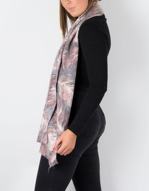 an image showing a cashmere mix scarf with a pink feather print