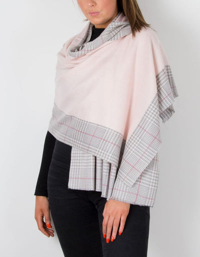 a cashmere mix scarf in pink with a herringbone border
