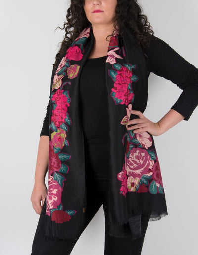 an image showing a floral print scarf in black and pink