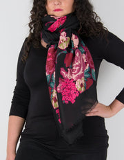 an image showing black scarf with pink floral print