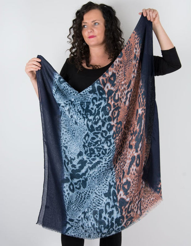 an image showing a leopard print scarf in blue and orange