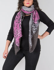 an image showing a leopard print scarf in grey and pink