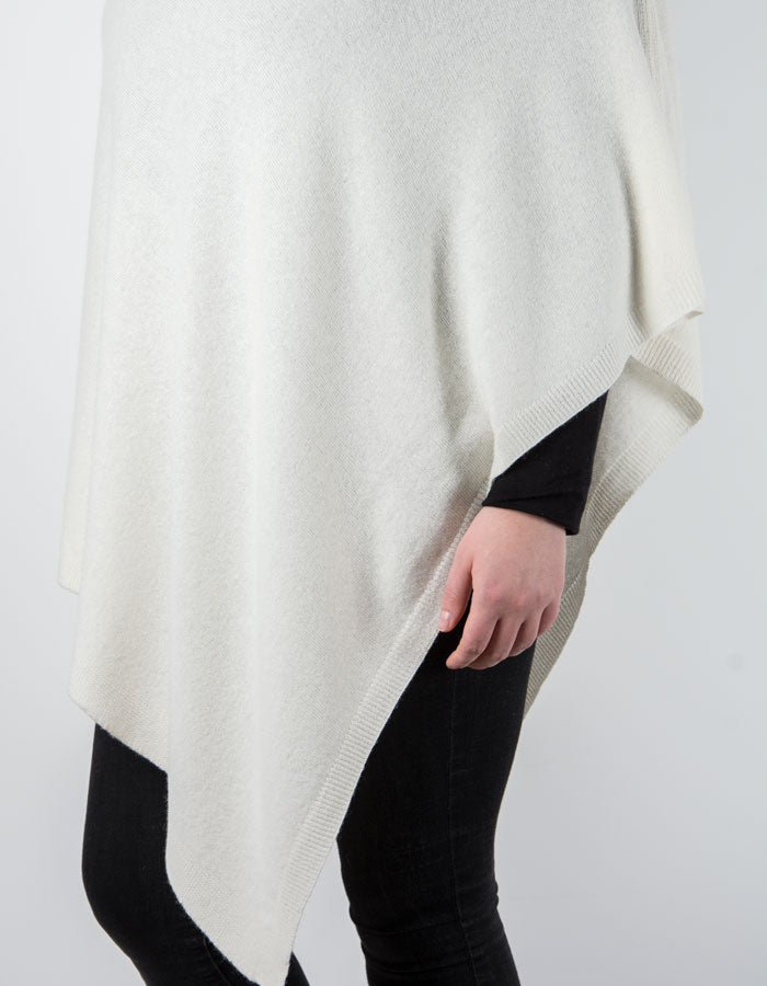 an image showing a white poncho