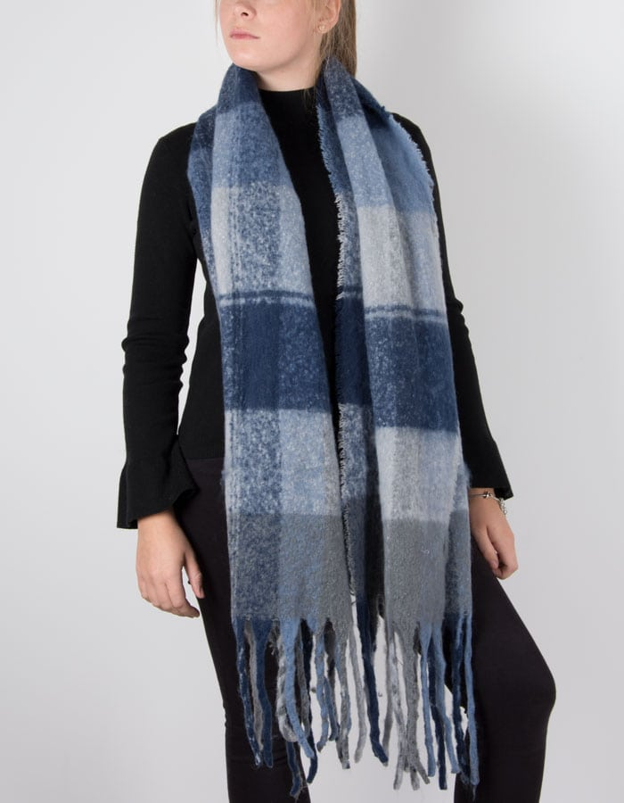 an image showing a winter knit check scarf with blue tassel