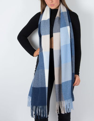 an image showing a winter knit check scarf in blue