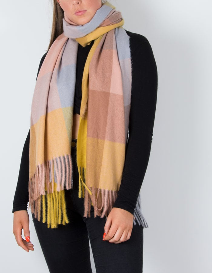 an image showing a winter check scarf in mustard