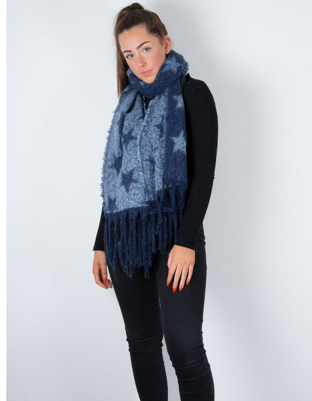 an image showing a winter knit scarf with a blue star