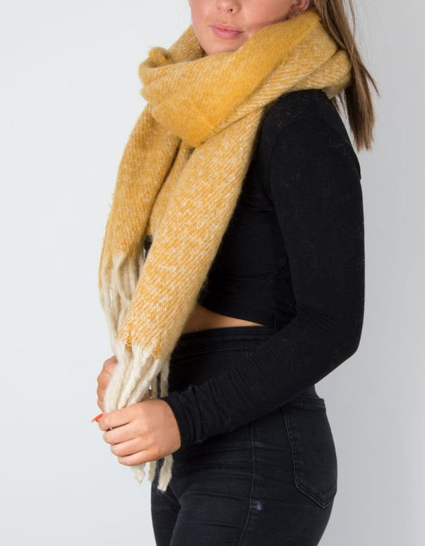 An image showing a winter knot scarf in mustard
