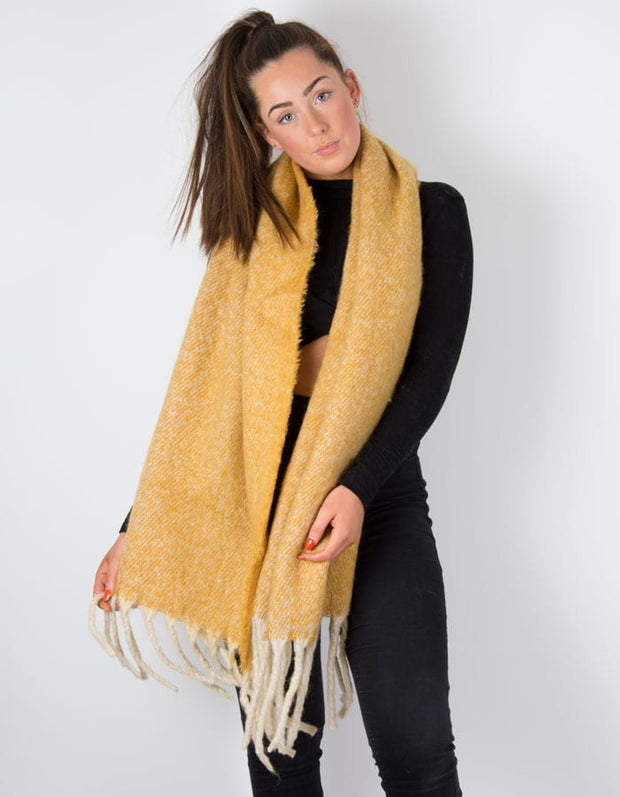an image showing a mustard winter knit scarf