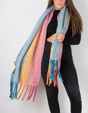 an image showing a rainbow knit winter scarf
