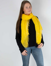 an image showing a yellow scarf
