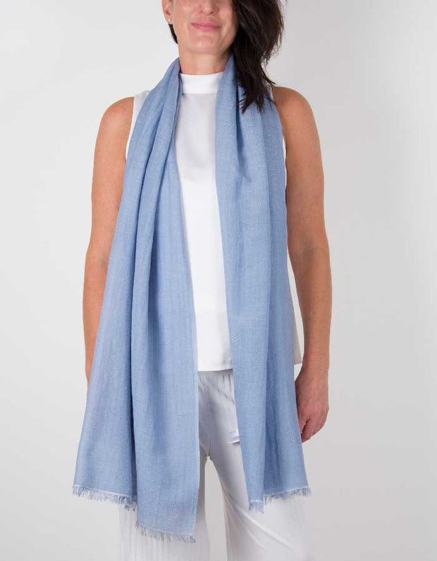 an image showing a silk wool mix wedding shawl in blue
