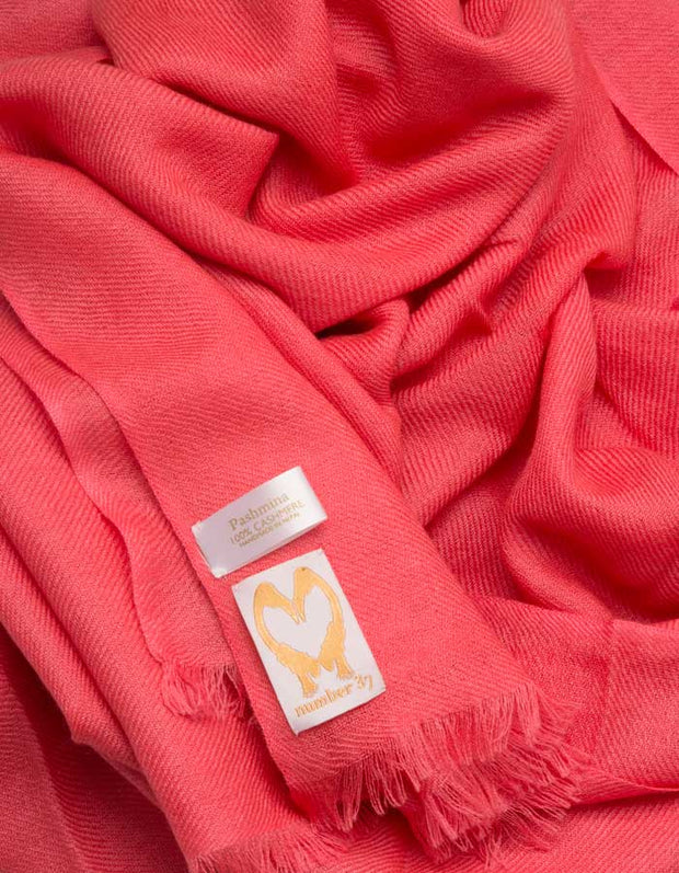an image showing a coral cashmere pashmina scarf