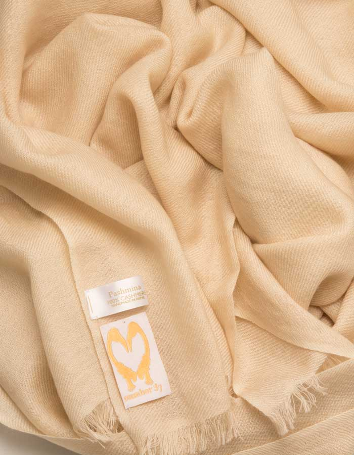 an image showing a pure cashmere pashmina scarf in cream