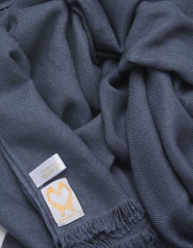 an image showing a pure cashmere pashmina scarf in dark grey