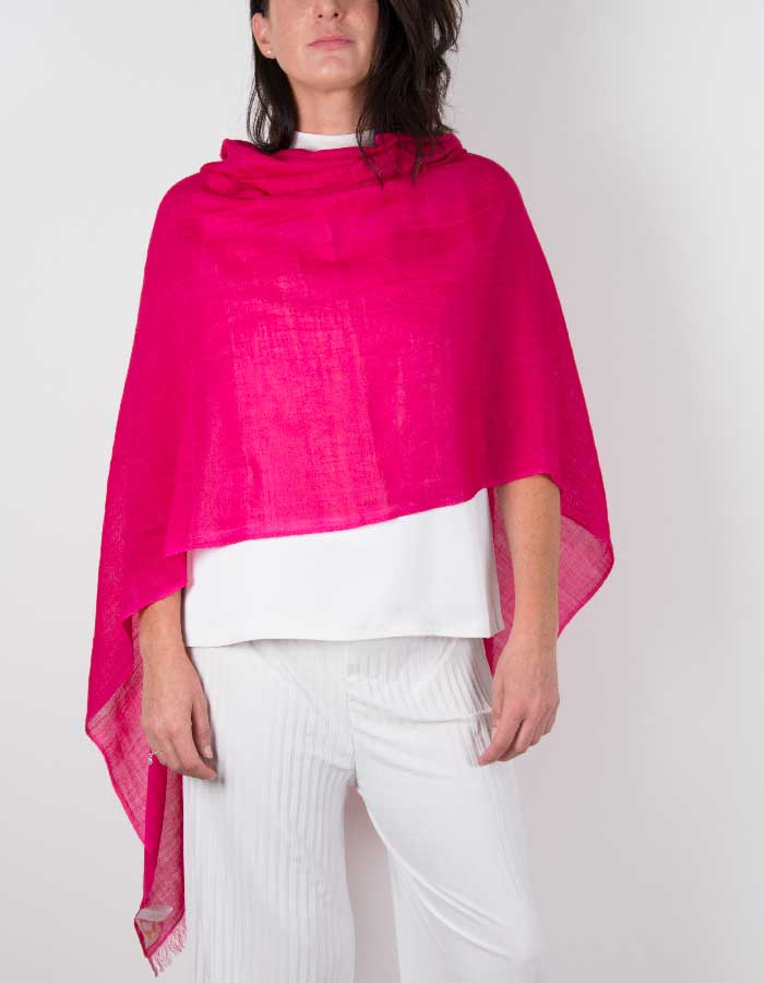 an image showing a silk wool mix wedding shawl in hot pink