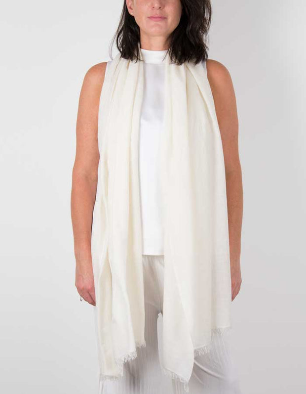 an image showing a silk wool mix wedding shawl in ivory