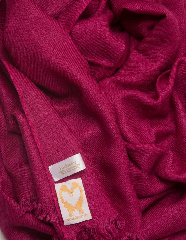 an image showing a pure cashmere pashmina scarf in mulberry