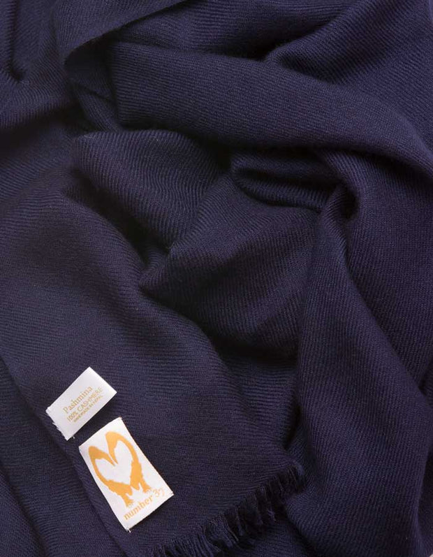 an image showing a navy cashmere pashmina scarf