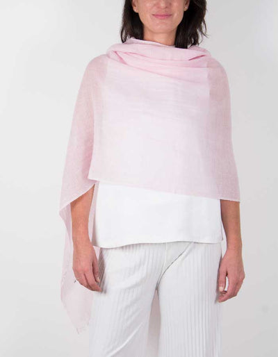 an image showing a silk wool mix wedding shawl in pale pink