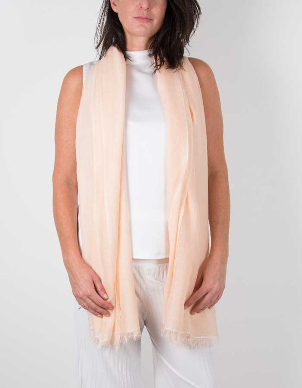 an image showing a silk wool mix wedding shawl in peach