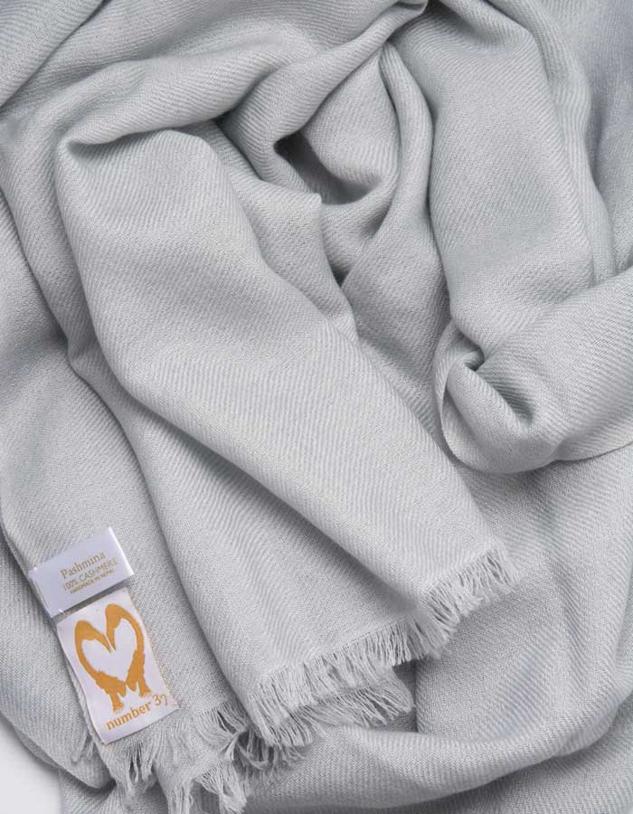an image showing a pale grey pashmina scarf