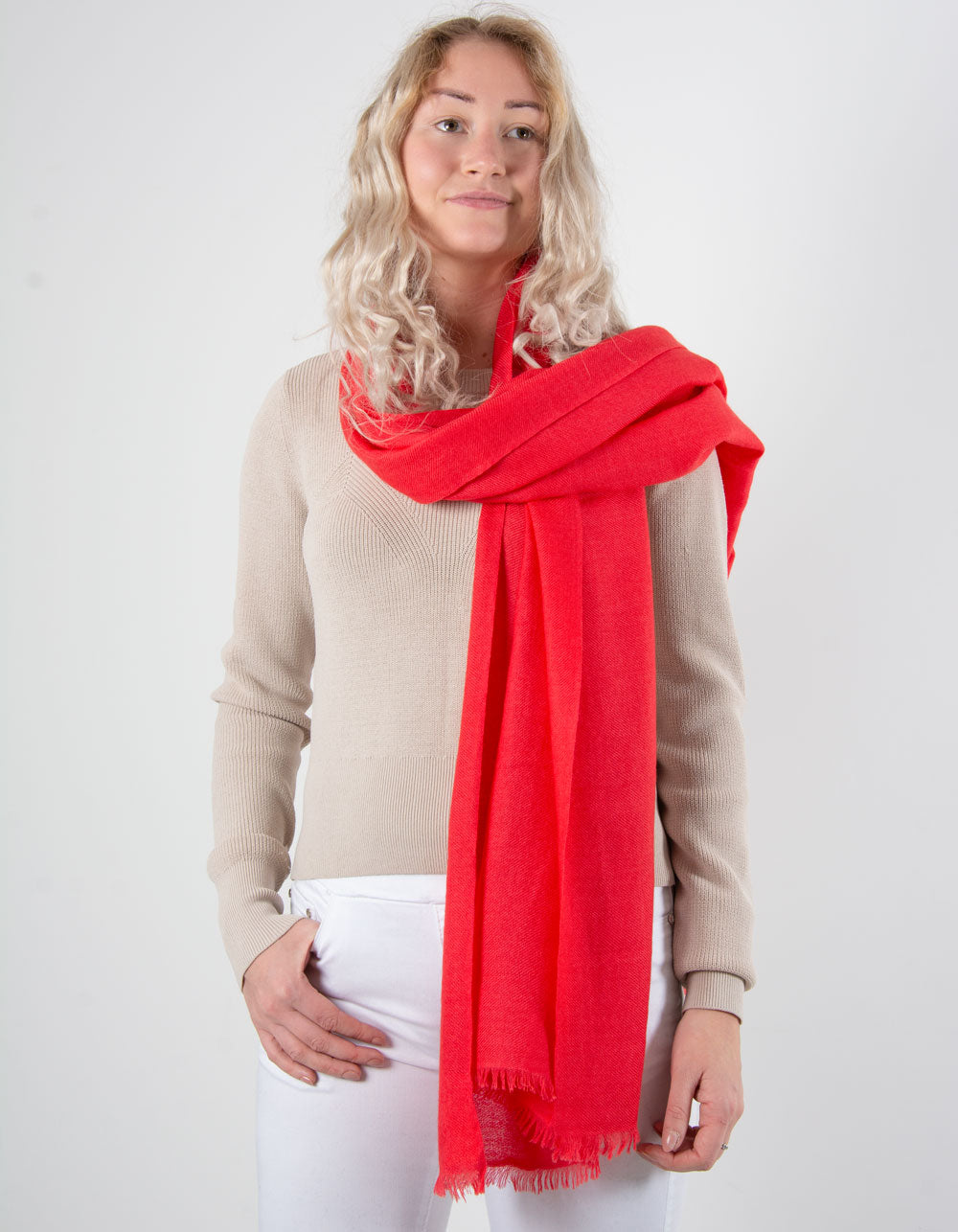 an image showing a pure cashmere pashmina in coral