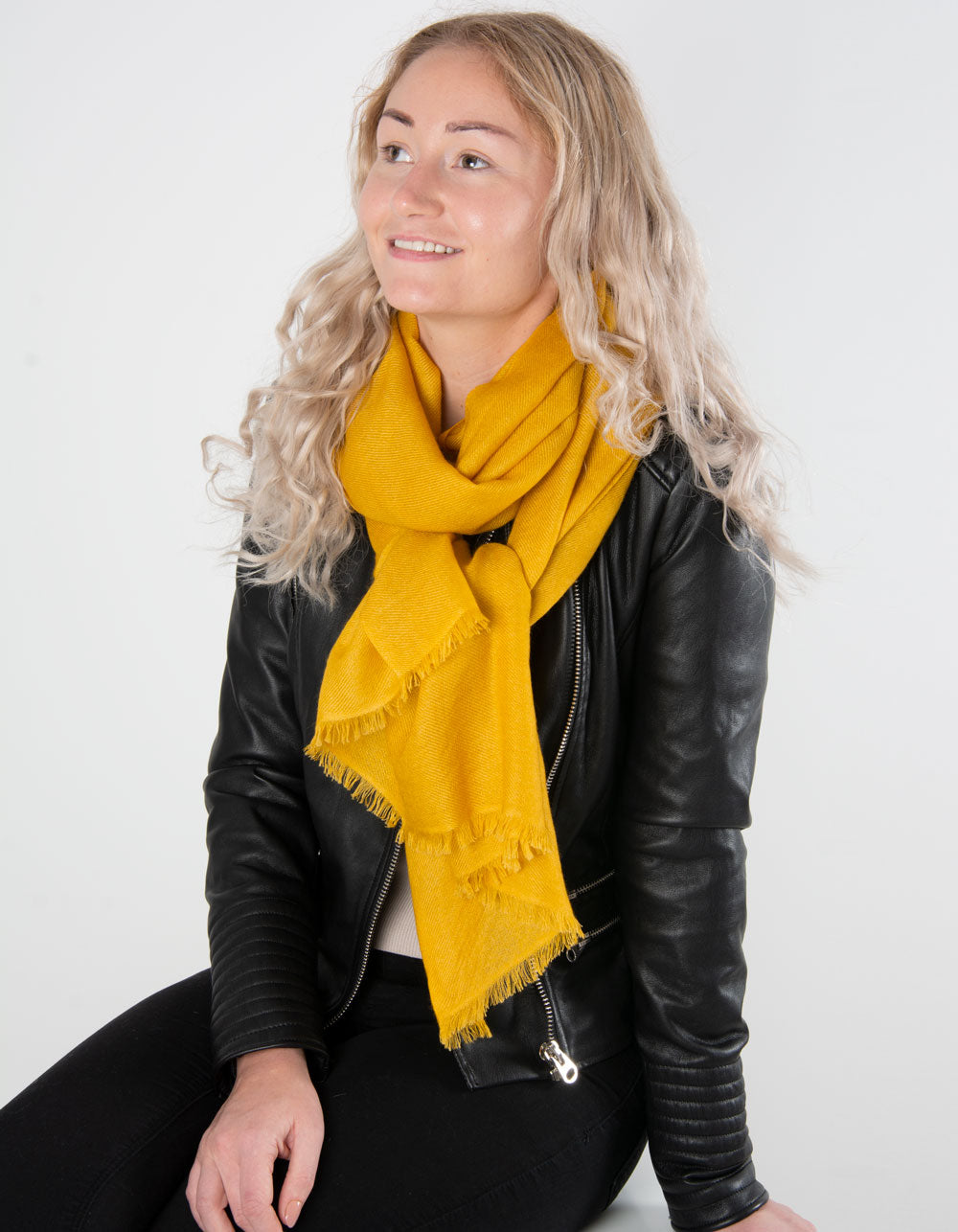 an image showing a pure cashmere pashmina in mustard