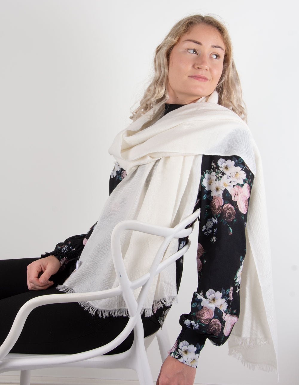 an image showing a pure cashmere pashmina in ivory