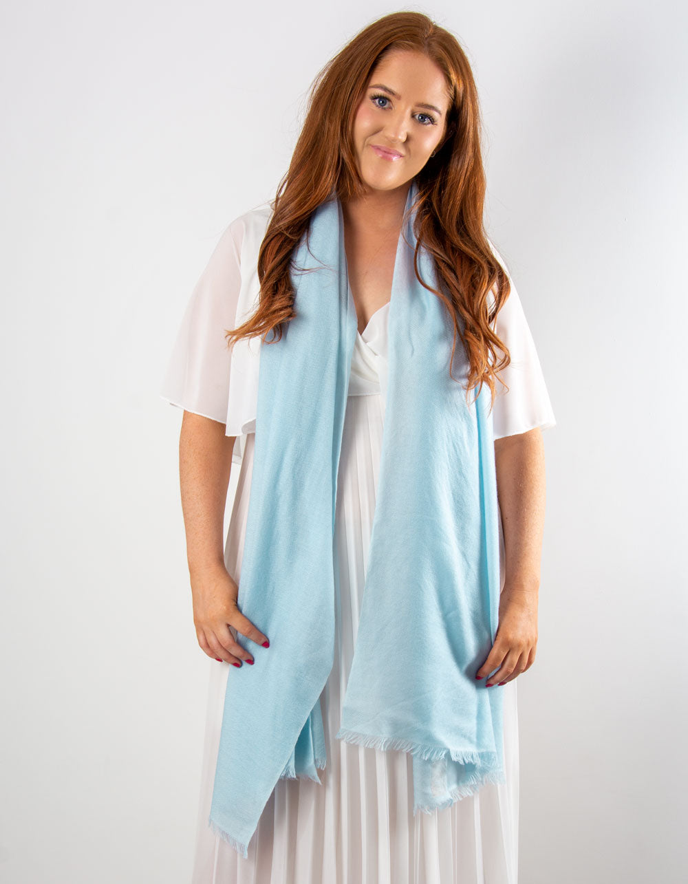 an image showing a cashmere wedding pashmina in baby blue