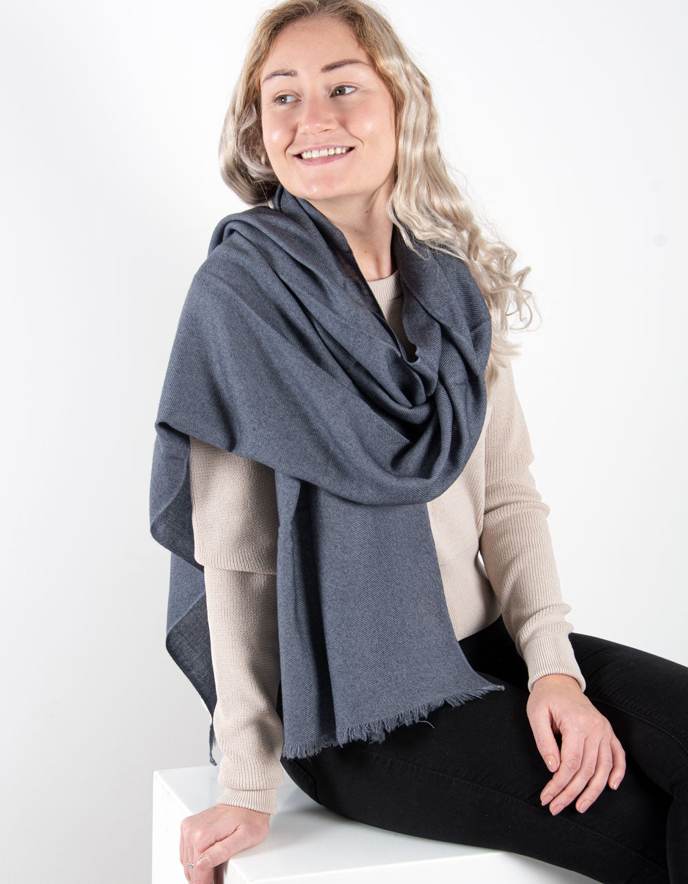 an image showing a pure cashmere pashmina in dark grey