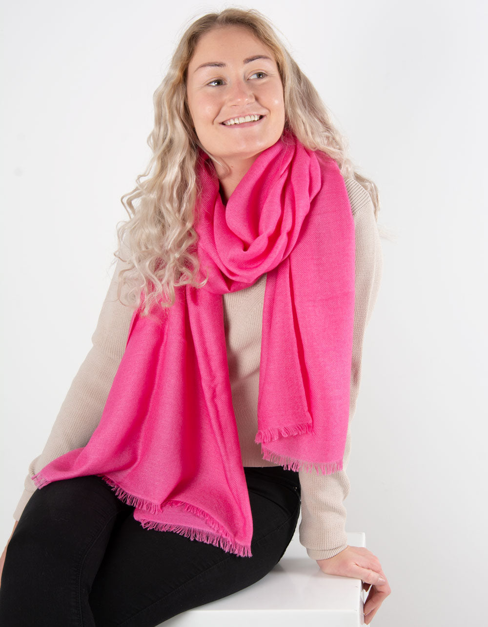 an image showing a pure cashmere pashmina in hot pink