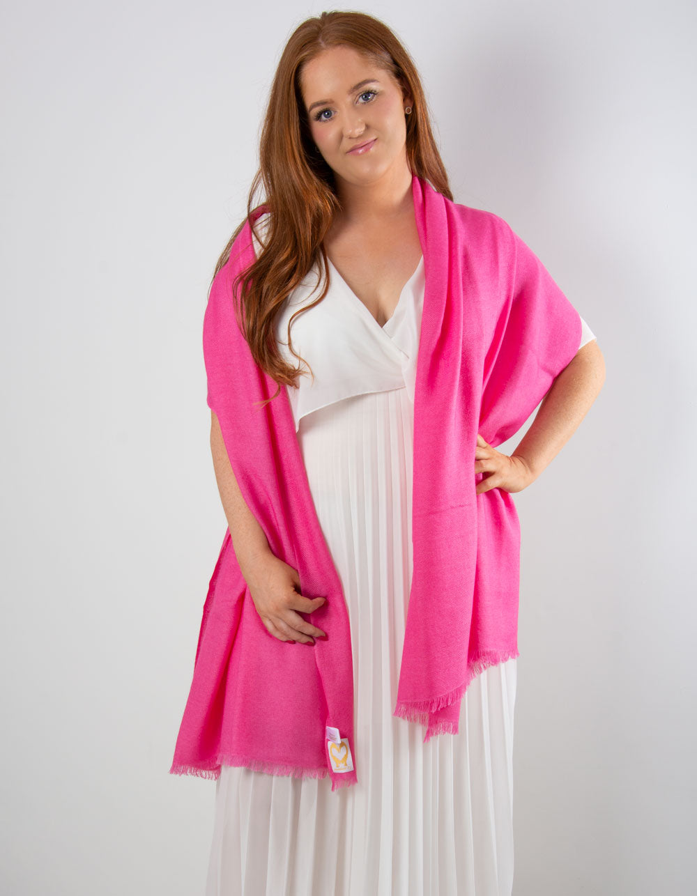 an image showing a cashmere wedding pashmina in hot pink