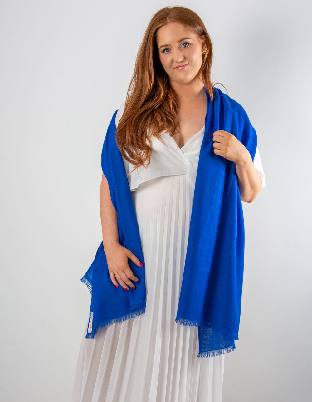 an image showing a cashmere wedding pashmina in cobalt