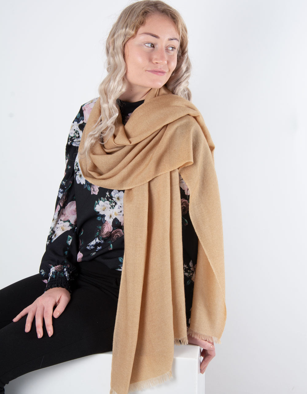 an image showing a pure cashmere pashmina in gold