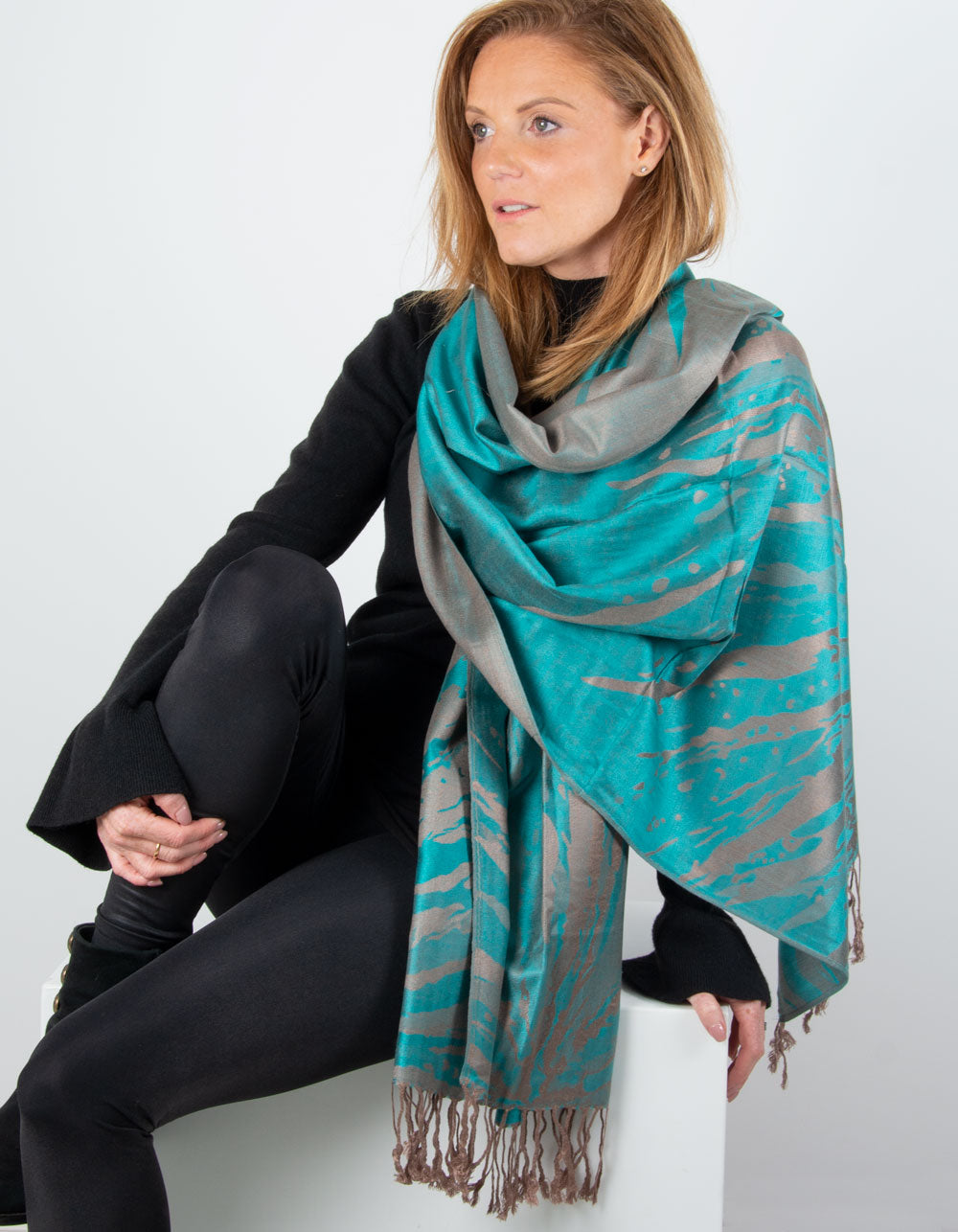 an image showing a green and bronze splash patterned pashmina