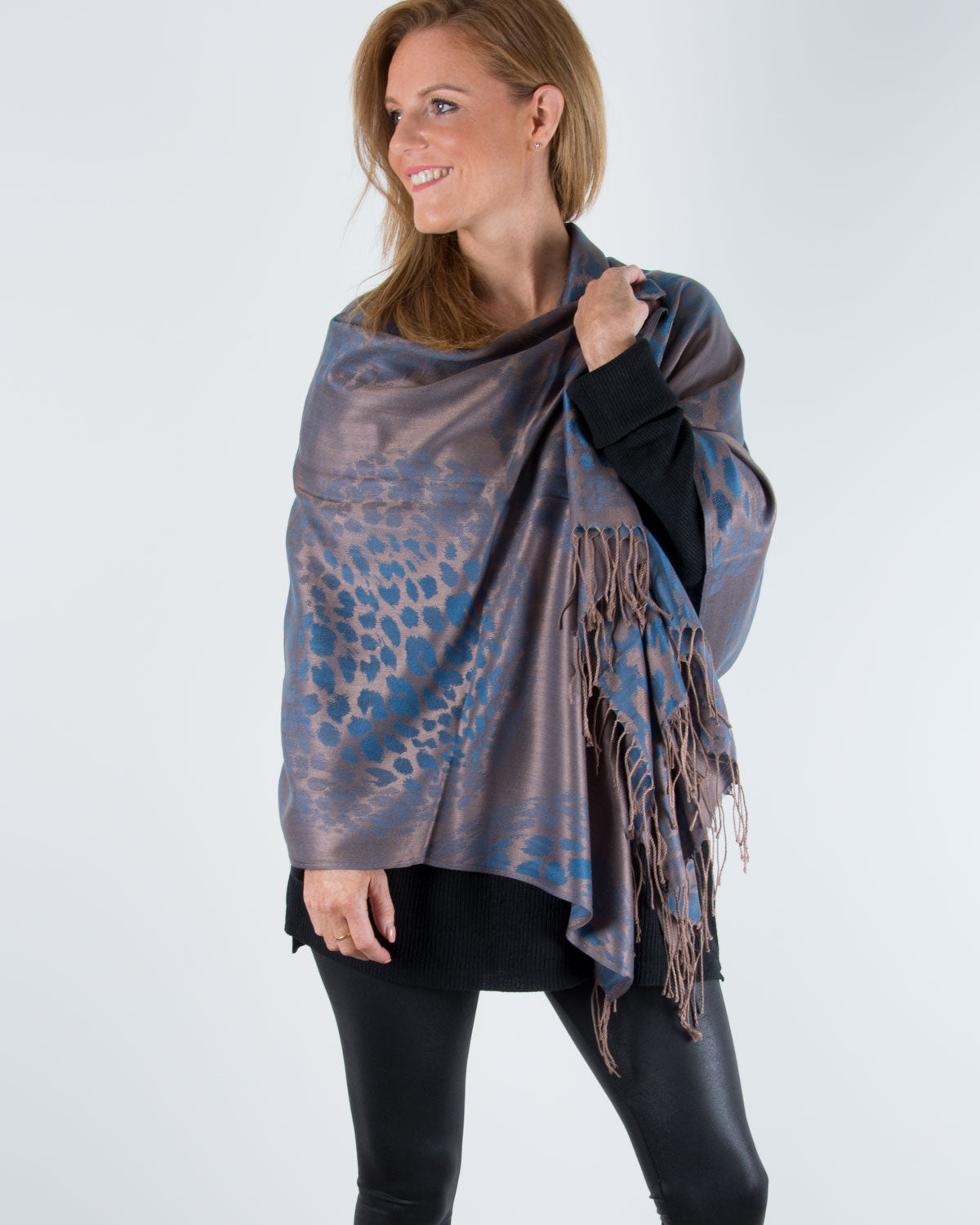 an image showing a blue and bronze animal print pashmina