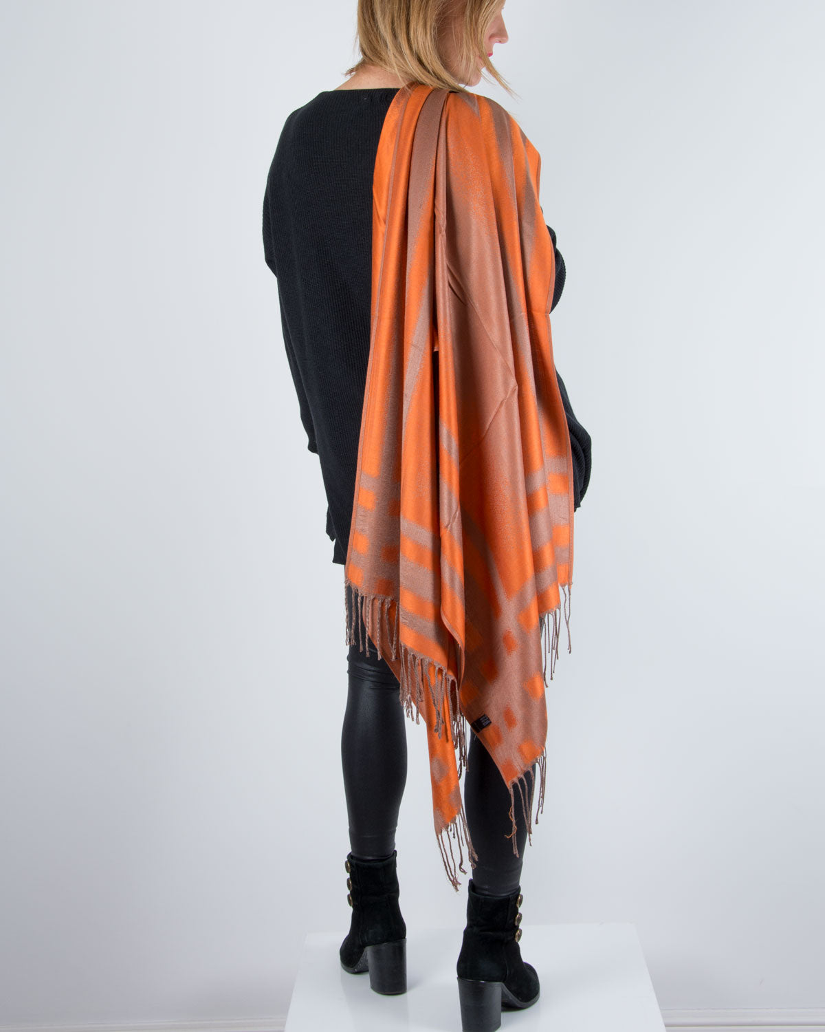 an image showing an orange and bronze pashmina