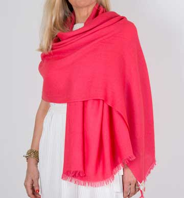 an image showing a cashmere wedding pashmina in coral