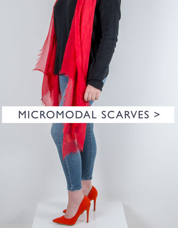 an image showing a red micromodal scarf