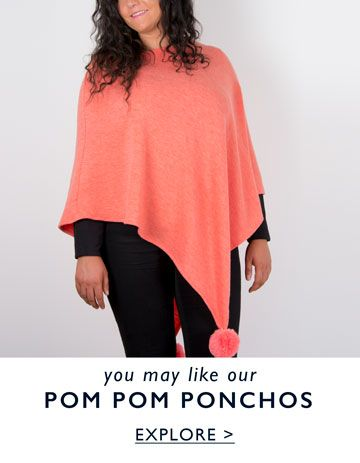 an image showing a pom pom poncho