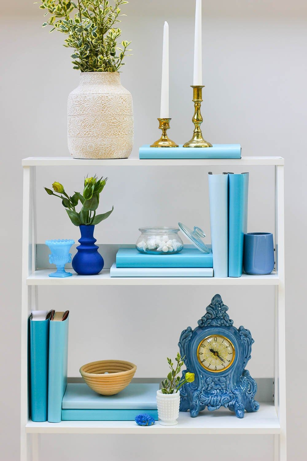 Styled blue book shelf with blue books from blue book covers