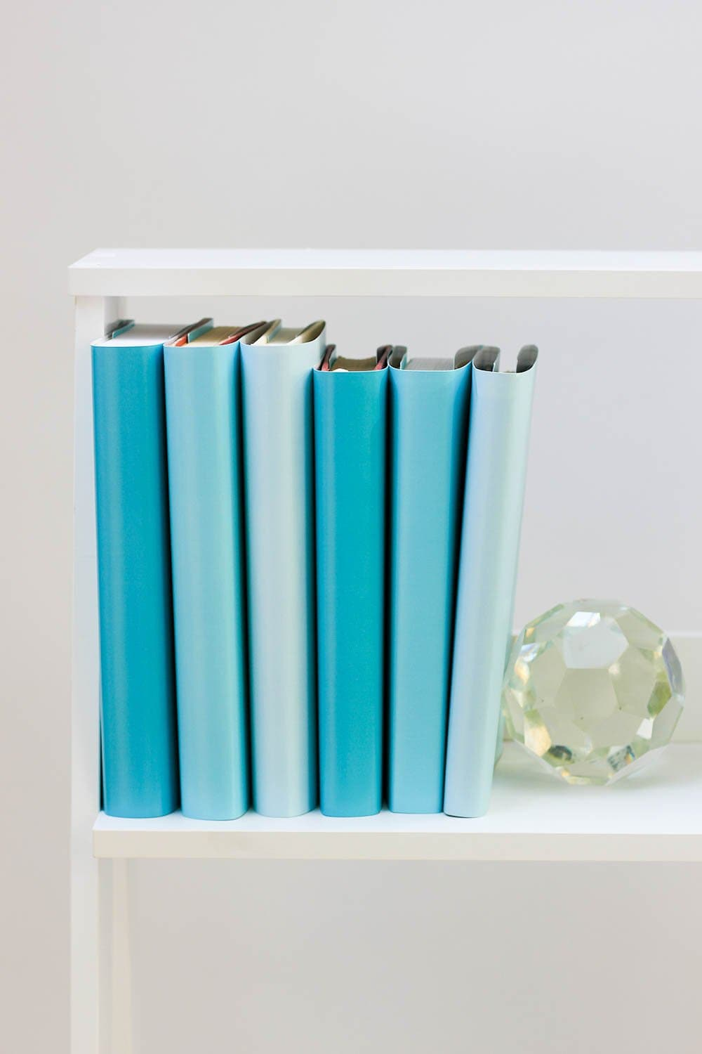 Large and small blue books from blue book covers