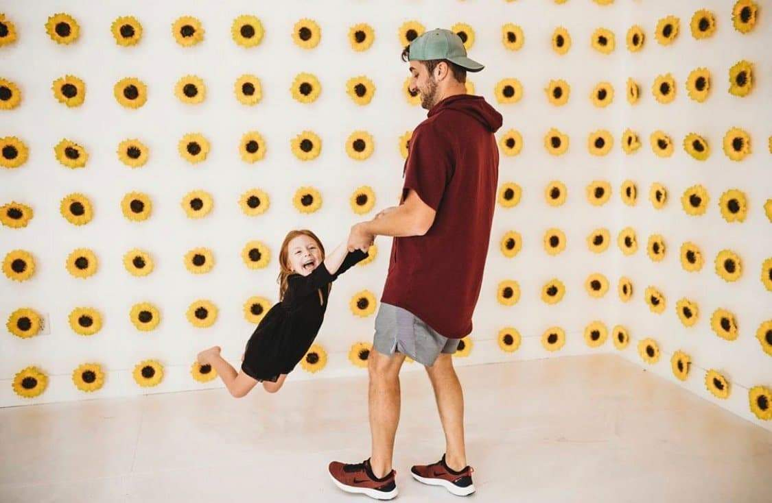 Child Ticket Picture - Dad swinging daughter in sunflower room