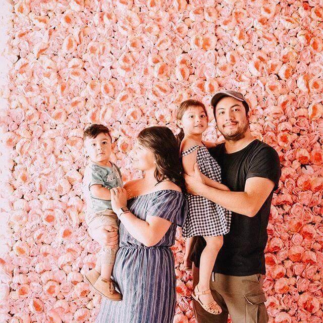 General Admission Ticket - Family in front of pink peony flower wall