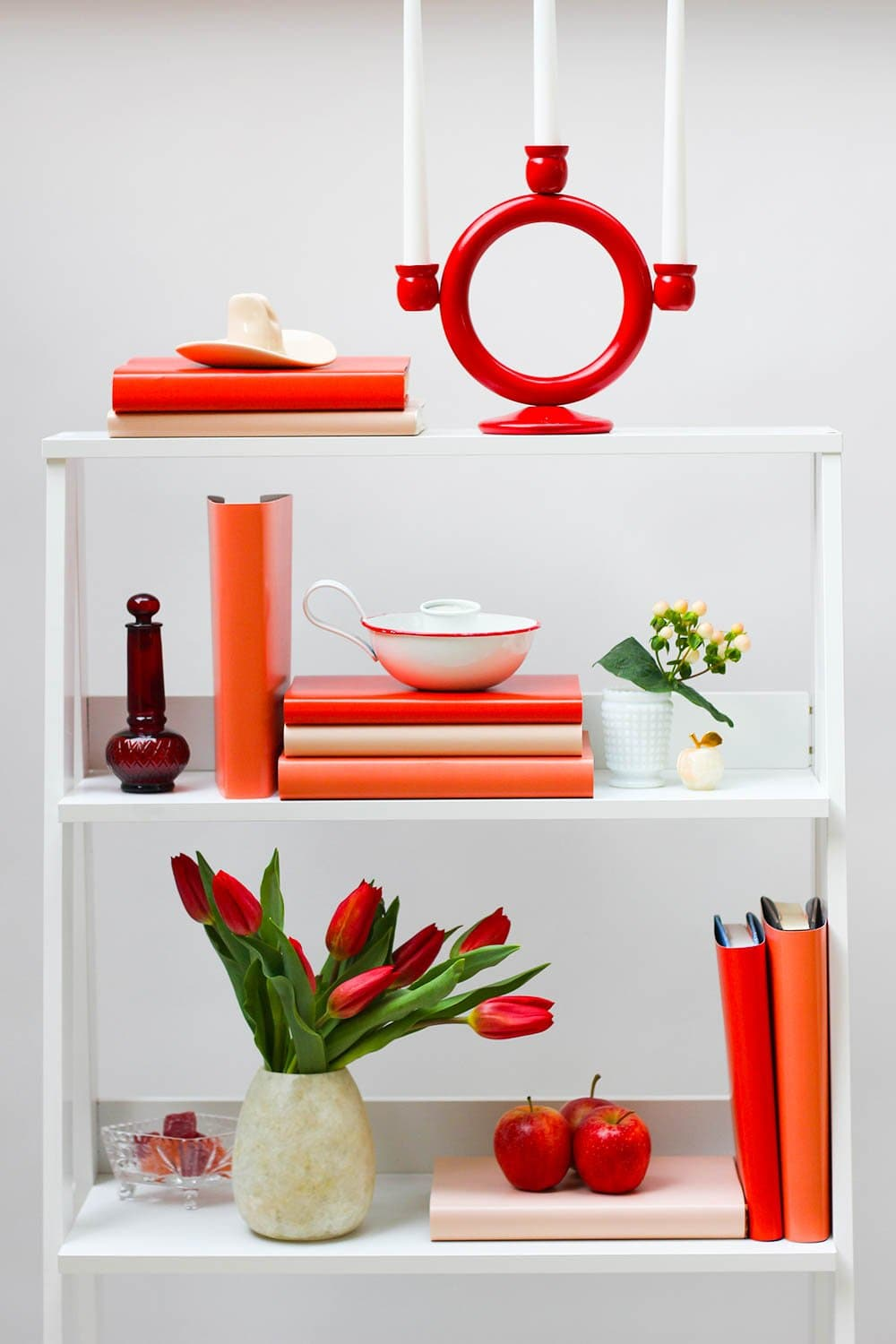Styled red book shelf with red books from red book covers