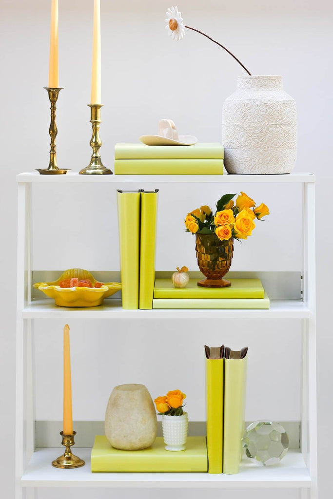 Styled yellow book shelf with yellow books from yellow book covers