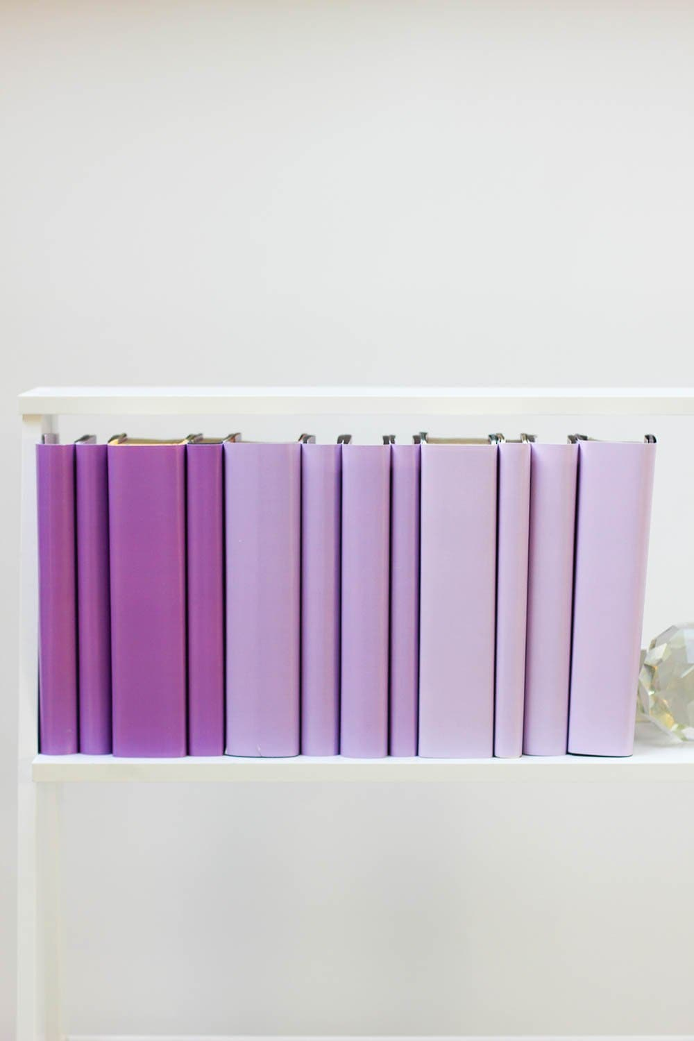 Set of styled purple books made with purple book covers